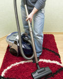 Cleaning by the vacuum cleaner Stock Photos