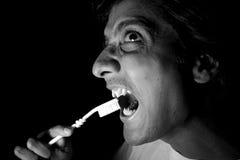 Cleaning Vampire Teeth Royalty Free Stock Photos