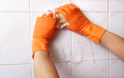 Cleaning wall. Royalty Free Stock Image