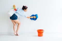 Cleaning the wall Royalty Free Stock Images