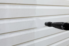 Cleaning the wall vinyl siding Stock Photo