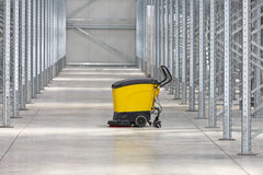 Cleaning Warehouse. Walk Behind Scrubber Machine For Cleaning Warehouse Floor stock image