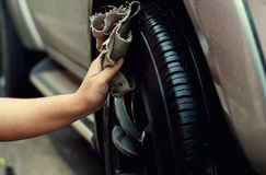 Cleaning car,taking care and cleaning. Cleaning wheel car,taking care and cleaning his new car Royalty Free Stock Images