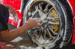 Hand Car Wash Sponge. Cleaning the wheel car wash with a sponge Stock Photography