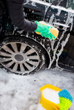 Cleaning the wheel car wash with a sponge Stock Photos