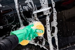 Cleaning the wheel car wash with a sponge Stock Image