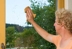 Cleaning a window Stock Photos