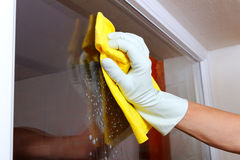 Cleaning window. Royalty Free Stock Photos