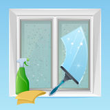 Cleaning window. On a blue background Royalty Free Stock Image