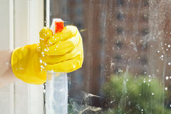 Cleaning window glass from spray bottle Stock Photos