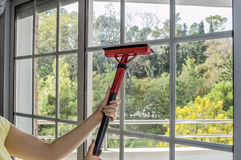 Cleaning window with machine Royalty Free Stock Image