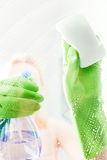 Cleaning window pane with detergent Royalty Free Stock Images