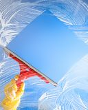 Cleaning window with squeegee blue sky Stock Images