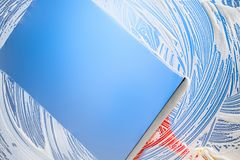 Cleaning window with squeegee blue sky Stock Photo
