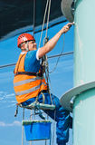 Cleaning windows. A man cleaning windows on a high rise building Stock Image