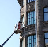 Cleaning of windows. Work at height Royalty Free Stock Photo