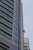 Cleaning windows a high rise building Stock Images