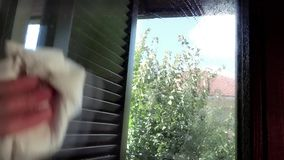 Cleaning windows stock footage