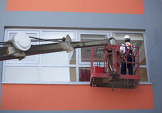 Cleaning windows with lift royalty free stock photo