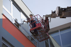 Cleaning windows with machine stock photography