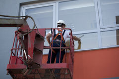 Cleaning windows with machine Stock Photo