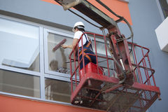 Cleaning windows with machine Royalty Free Stock Photography