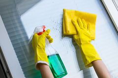 Cleaning windows with special rag Stock Image