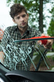 Cleaning windscreen in a car Stock Photos
