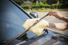 Cleaning a windshield wiper. With microfiber cloth Stock Image