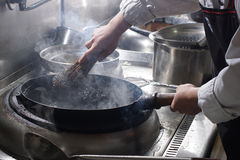 Cleaning Wok With Wooden Sticks And Metal Wire Royalty Free Stock Image