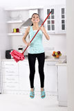 Cleaning woman happy jumping Stock Image