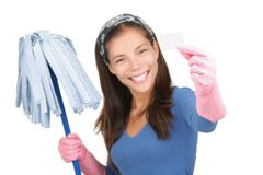 Cleaning woman holding white sign. Or business card with copy-space. Isolated on white background. Shallow depth of field, focus on sign Stock Images