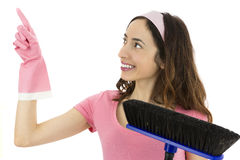 Cleaning woman pointing up to copy space. Happy cleaning woman showing up to product space Stock Photography