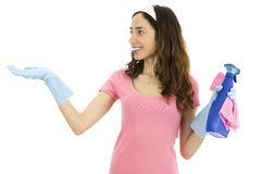 Cleaning woman presenting product space. Happy caucasian spring cleaning woman showing copy space with her hand Royalty Free Stock Image