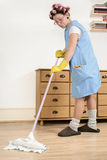 Cleaning. Woman scrubbing the house floor Royalty Free Stock Photos