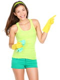 Cleaning woman showing. Cleaning woman pointing and showing your product or text isolated on white background. Beautiful young mixed race woman wearing yellow Stock Images