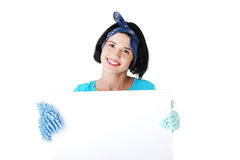 Cleaning woman showing blank sign board. Stock Images