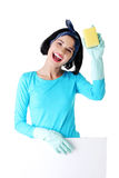 Cleaning woman showing blank sign board. Smiling happy cleaning woman showing blank sign board Stock Photography