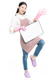 Cleaning woman showing blank sign board. Chinese cleaning woman showing sign poster cleaning isolated on white background Stock Image