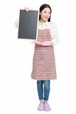Cleaning woman showing blank sign board. Chinese cleaning woman showing sign poster cleaning isolated on white background Stock Images