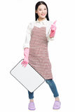 Cleaning woman showing blank sign board. Chinese cleaning woman showing sign poster cleaning isolated on white background Stock Photo