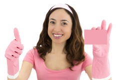 Cleaning woman showing a blank sign card and giving thumbs up Royalty Free Stock Photography