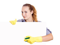 Cleaning woman showing sign. Poster cleaning on white background. Smiling happy caucasian cleaning lady Stock Image