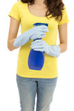 Cleaning woman with a spray bottle. Cleaning woman holding a spray detergent in her hands Royalty Free Stock Photo