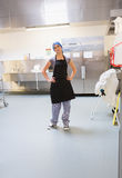 Cleaning woman standing in kitchen Royalty Free Stock Images