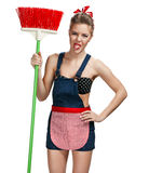 Cleaning woman standing unpleasant while spring cleaning with broom Royalty Free Stock Image