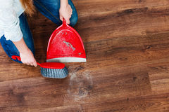 Cleaning woman sweeping wooden floor Stock Photos