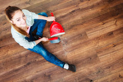 Cleaning woman sweeping wooden floor Stock Image