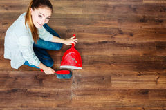 Cleaning woman sweeping wooden floor Royalty Free Stock Images