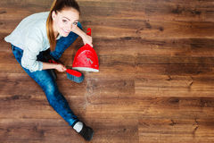 Cleaning woman sweeping wooden floor Stock Photography